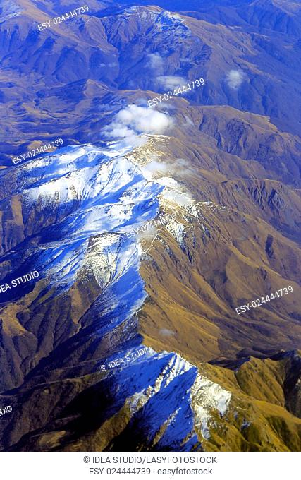 Aerial view of Caucasus mountains white clouds