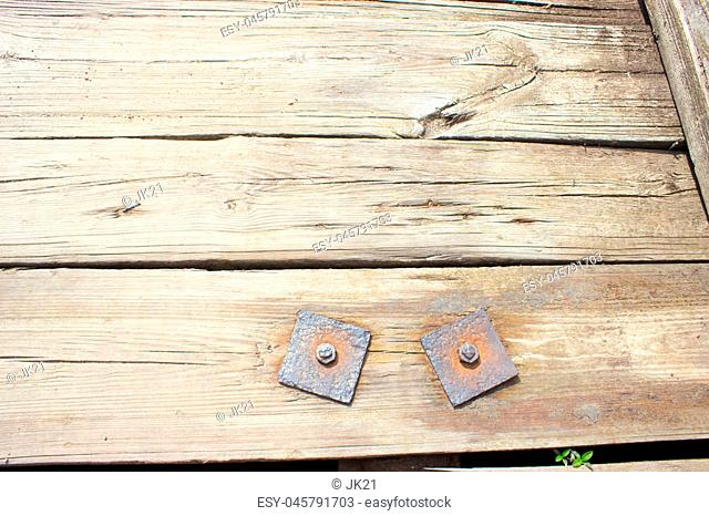 Rusty bolts with washers - a component of a wooden bridge