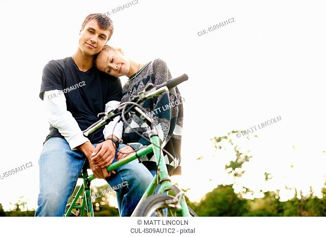 Portrait of romantic young couple with bicycle
