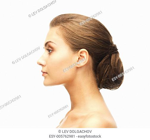 beauty concept - face of woman with beautiful hairstyle