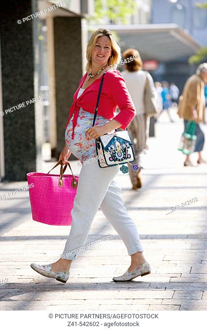 Pregant woman is shopping in shopping-center