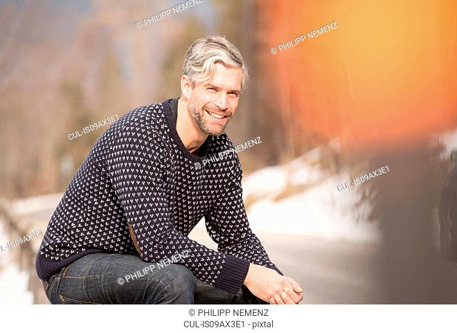 Portrait of mid adult man, outdoors, smiling
