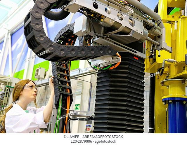 Robotic mobile platform for aeronautical drilling. Researcher working on portable robot to drill holes into aircraft components, Industry