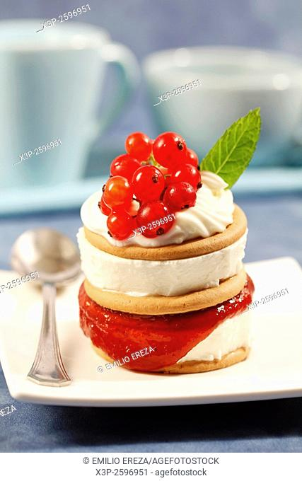 Cookies tower with cheese and red currants