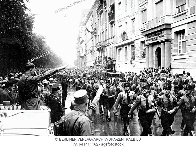 The image from the Nazi Propaganda! shows Adolf Hitler (l) on the occasion of the great Gautag (Gau Day) of the National Socialists in Munich, Germany
