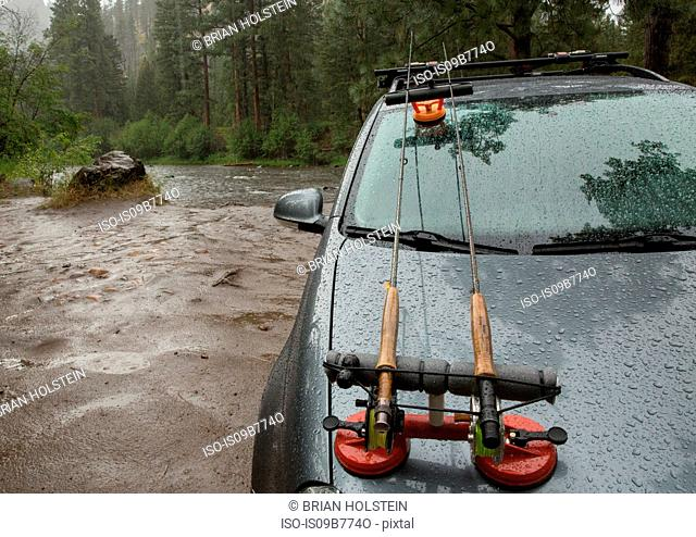 Vehicle parked by river in rain, Clark Fork, Montana and Idaho, US