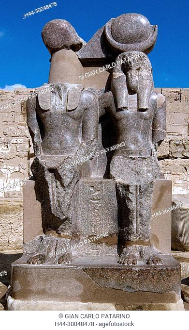 Medinet Habu, Luxor, Egypt, Djamet, mortuary temple of King Ramses III,( XX dyn. 1185 -1078 B.C) – a double statue of two gods in the hypostyle hall
