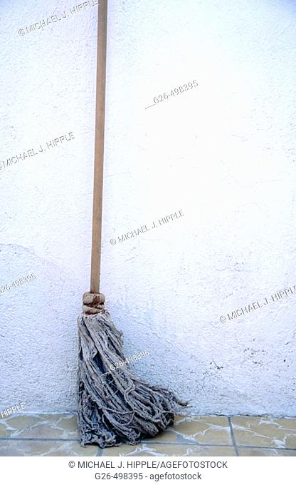 Broom leaning against wall, Guanajuato. Mexico