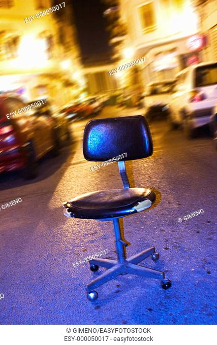 Office chair in the street