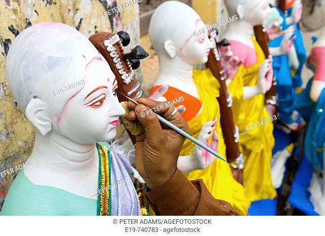Sarasvati (Female Hindu God) idol being painted, Kolkatta (Calcutta). West Bengal, India
