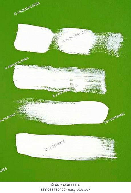 White brush strokes on bright green background