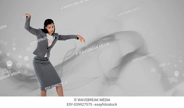 Woman dancing with grey smoke swirls