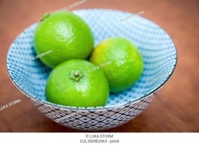 Three limes in a bowl