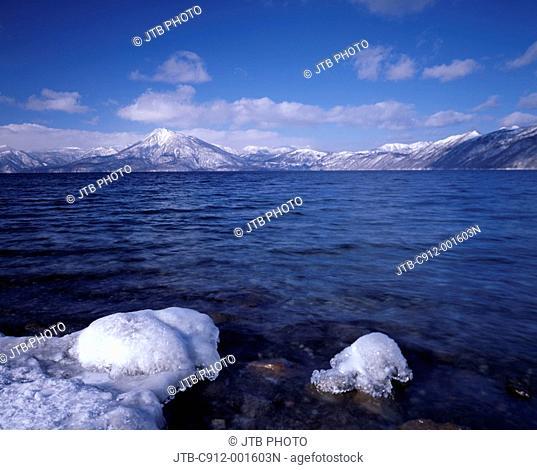 Blue sky Clouds Snow-covered mountain White Lake Shikotsu Chitose Hokkaido Japan
