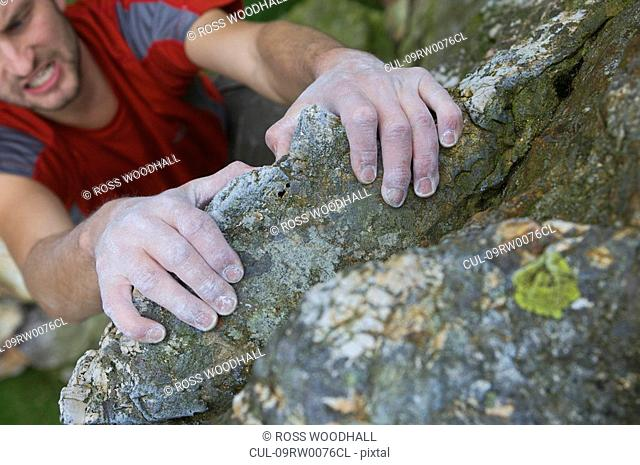 Climbers hands on a rock face