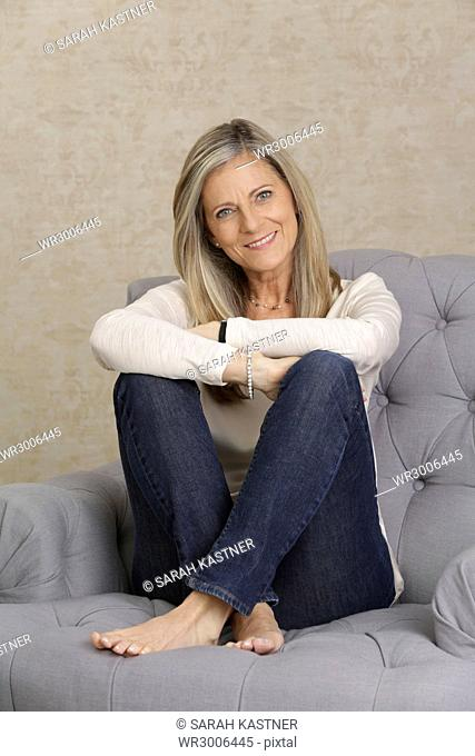 Middle-aged woman sitting on a couch