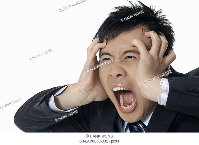 Businessman Suppressing his face and shouting
