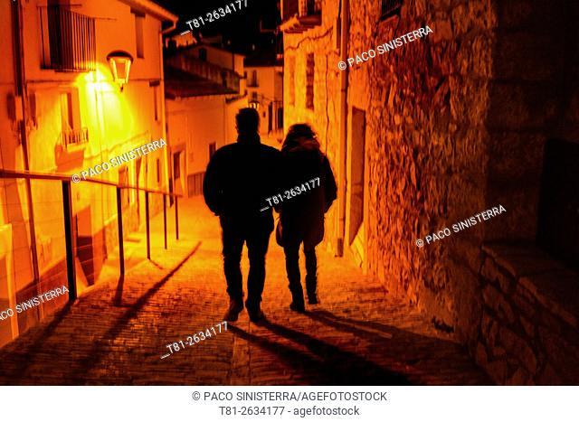 Couple walking in Morella, Castellon, Spain