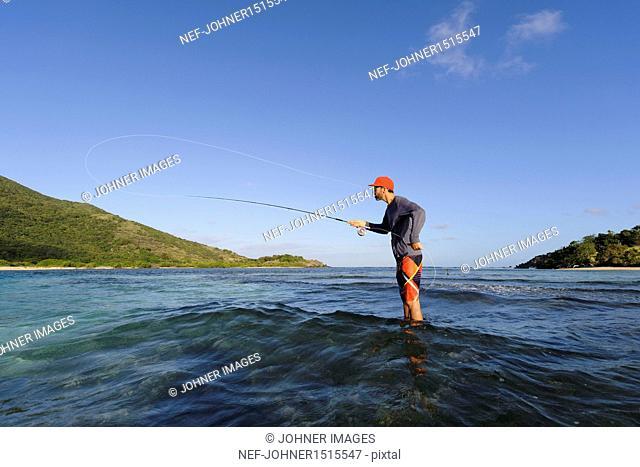 Man fishing, side view