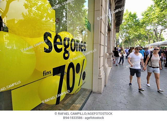 Discount sign on shop window, Passeig de Gracia, Barcelona, Catalonia, Spain