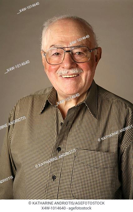 A senior citizen man poses for a portrait