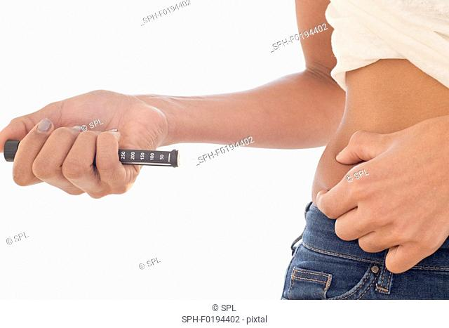 Woman injecting herself in tummy