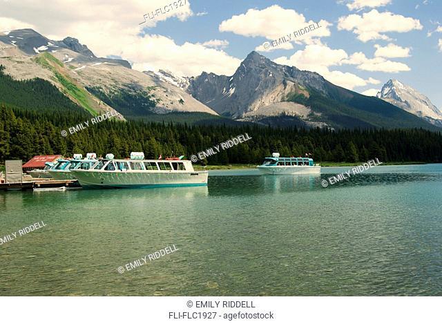 Tour boat arrives at dock after trip on Maligne Lake, Jasper National Park, Alberta, Canada