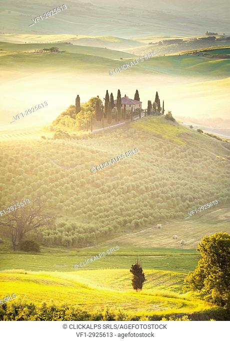Podere Belvedere, the famous italian farmhouse, during sunrise. Val d'Orcia, Siena province, Tuscany, Italy