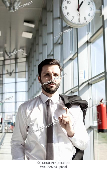Portrait of businessman in shirt and tie in airport