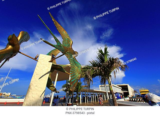 Mexico, Quintana Roo, Cozumel Island. San Miguel de Cozumel. A Swallow bronze statue at the ferry dock