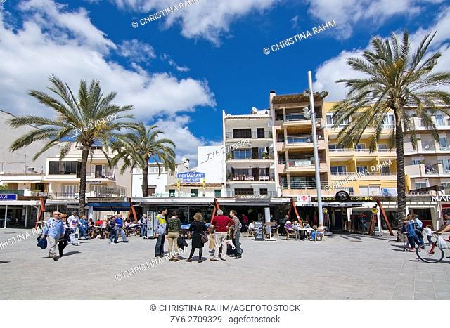 People out and about in spring sunshine in Puerto Alcudia, Mallorca, Balearic islands, Spain in April