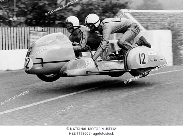 Sidecar TT race, Isle of Man, 1970. This motorcycle and sidecar combination are airborne as they cross Ballaugh Bridge on the TT circuit