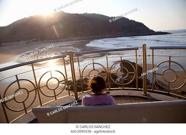 Woman Relaxing At The Sunset In Deba, Guipuzcoa, Basque Country, Spain