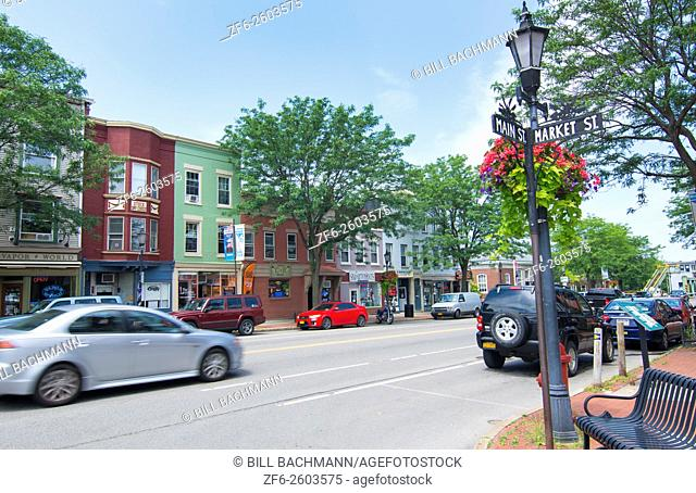 Brockport New York NY small town with downtown with traffic on Main Street in college town village and Victorian Village on the Erie Canal