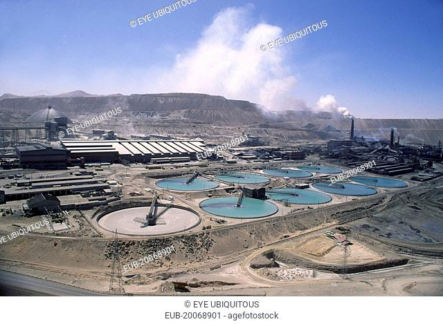 Copper Mine, smoke coming out of a stack in the distance. General industrial landscape