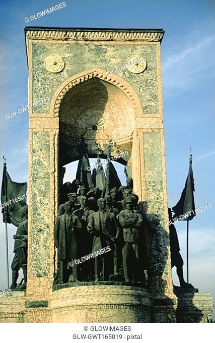 Low angle view of a monument, Cumhuriyet Aniti, Taksim Square, Istanbul, Turkey
