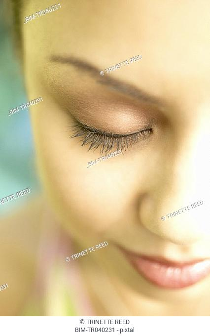 Close up of young woman with eyes closed