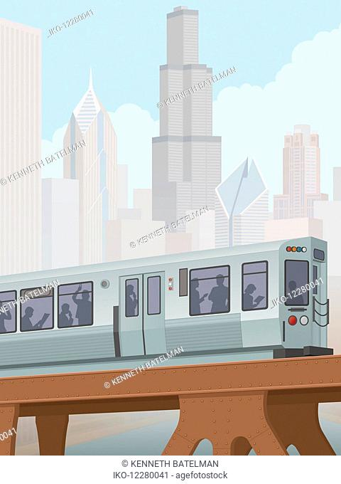 Commuters on train on elevated railway track in Chicago city center