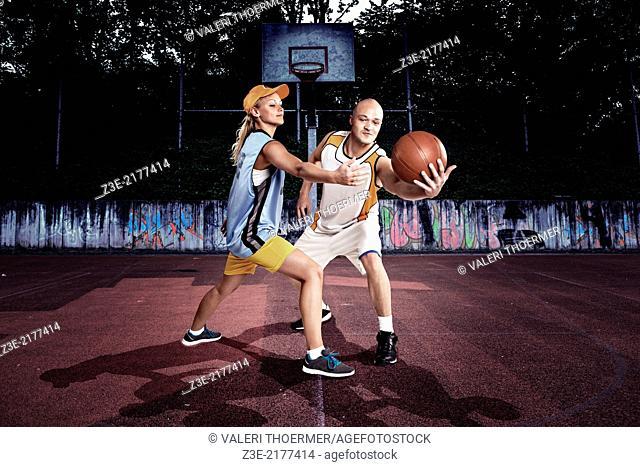 young basketball players on a street basketball court