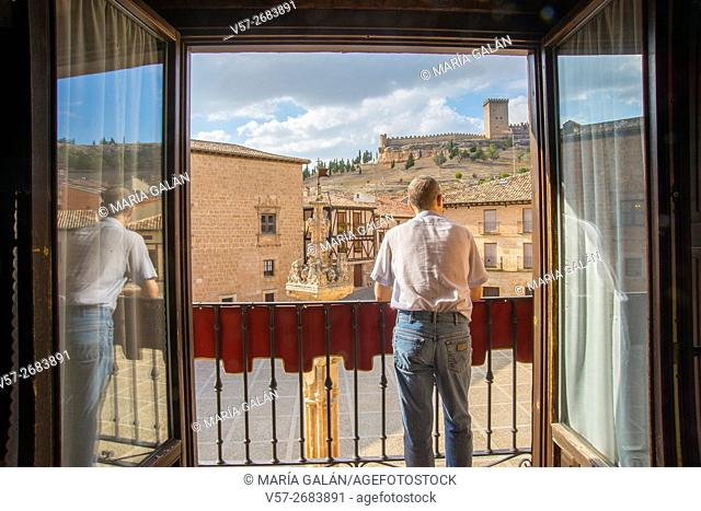 Man at the balcony of a rural hotel. Peñaranda de Duero, Burgos province, Castilla Leon, Spain