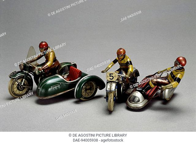 Motorcycle with sidecar, painted tin toy, made by Tipp & Co, 1957. Germany, 20th century.  Milan, Museo Del Giocattolo E Del Bambino (Toys Museum)