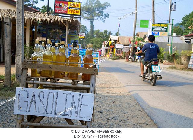 Whiskey and rum bottles with gasoline, gas station, Koh Chang Island, Thailand, Asia