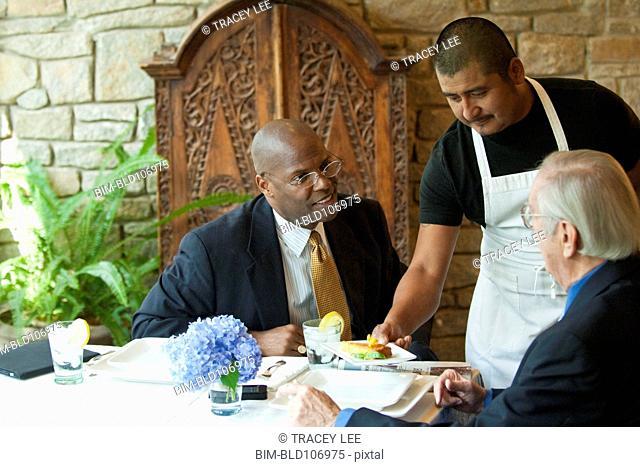 Businessmen having lunch in restaurant