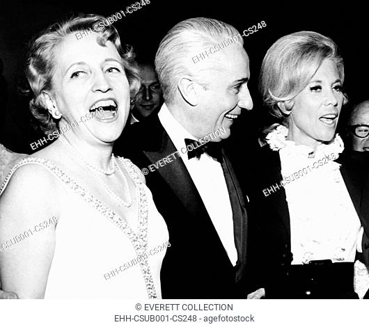 Margaret Truman Daniel and husband Clifton with entertainer Dinah Shore at her new supper club. Clifton Daniel was managing editor of the NY Times
