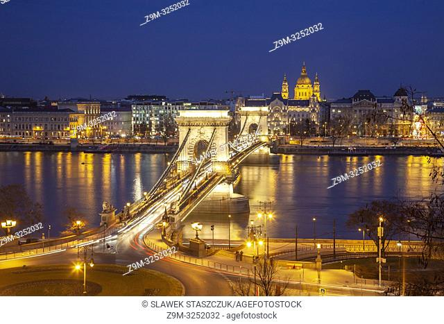 Evening at the Chain Bridge in Budapest, Hungary. St Stephen cathedral dominates the skyline
