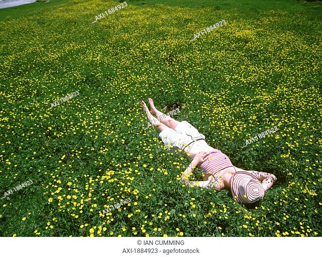 Woman Relaxing In Field Of Buttercups With The Cirque De Gavarnie In The Background