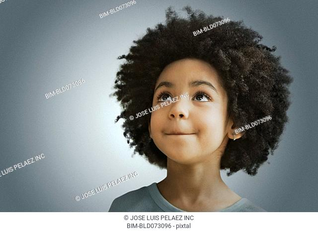 Mixed race girl looking in curiously