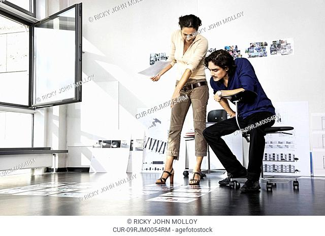 Man and woman working, architects