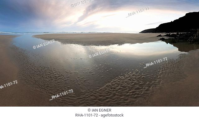 Sunset sky reflected in beach stream at Sandymouth Bay, Cornwall, England, United Kingdom, Europe