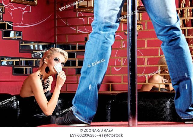 The man dances a striptease in night club